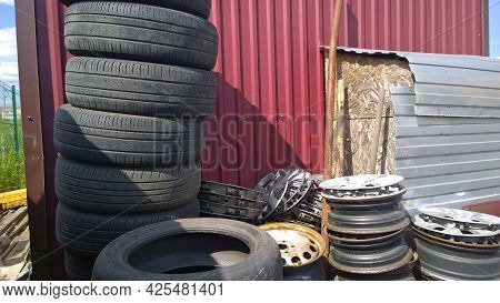 Heap Of Old Used Car Tires And Rim. Concept Of Problem Of Recycling Tyre And Wheel. Environmental Is