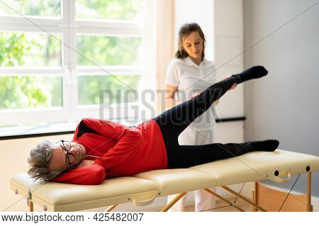 Physiotherapist Doing Thigh Rehabilitation Physio Therapy Massage