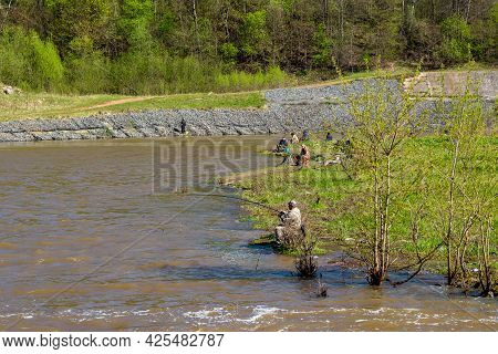 Fishermen Sit On The Bank Of The Protva River Near The Dam, Fishing With A Fishing Rod: Borovsk, Rus