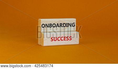 Onboarding Success Symbol. Wooden Blocks With Words Onboarding Success On Beautiful Orange Backgroun