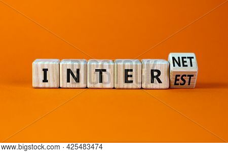Internet And Interest Symbol. Turned The Wooden Cube And Changed The Words Interest To Internet. Bea