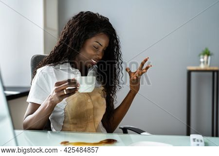 Spilled Coffee On White Shirt. Spill And Stain