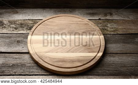 Empty Round Wooden Cutting Kitchen Board On Wooden Background, Pizza Board, Top View