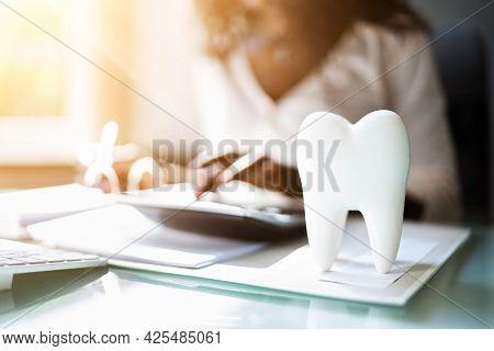 Dental Insurance Money. Dentist Service Desk And Implant Money