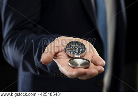 Businessman Holding A Navigation Compass In His Hand. Business Planning And Business Navigation For