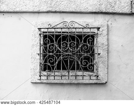 Old Window On Stone Wall With Rusty Iron Lattice In Alicante, Spain