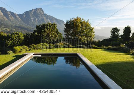 General view of tranquil swimming pool in stunning mountains countryside. outdoor retreat and holiday concept.