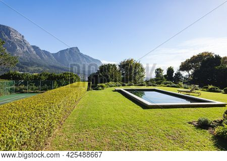 General view of tranquil swimming pool with stunning mountains countryside. outdoor retreat and holiday concept.