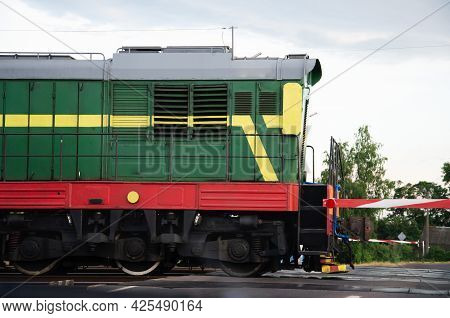 Diesel Electric Locomotives Train With Railroad. Perspective View Of Passenger Train Hauled By The D