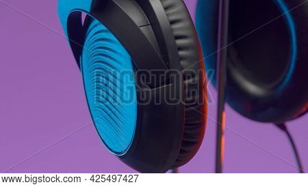 Monitor Headphones. Action. Beautiful Design Of New Model Of Headphones Hanging On Stand On Isolated
