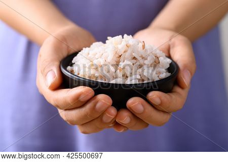 Organic Thai Highland Cooked Brown Rice In A Bowl Holding By Woman Hand (cargo Rice, Loonzain Rice O