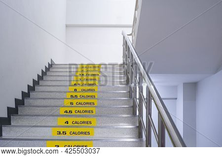 Stickers Of Calories Burned On Staircase Inside Of Office Building, Stairway For Healthy Concept