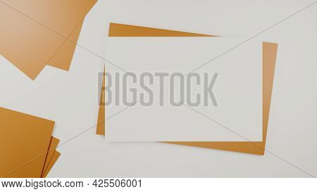 Blank White Paper On The Brown Paper Envelope. Mock-up Of Horizontal Blank Greeting Card. Top View O