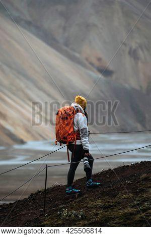 Female photographer at Landmannalaugar in the Fjallabak Nature Reserve, the Highlands of Iceland