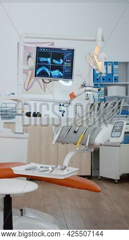Empty Dental Orthodontic Stomatology Office With Nobody In. Bright Modern Equipped Orthodontic Workp