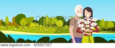 Happy Mature Couple With Flowers Standing Together Elderly Man Woman Having Romantic Relationships