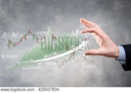 Businessman Hold Sales Data And Economic Growth Graph Chart. Business Planning And Strategy. Analysi