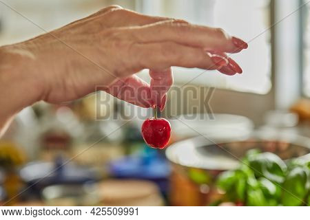 The Chef Takes Fresh Cherries For Making Pie