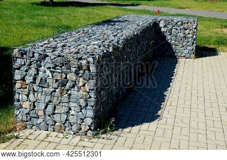 In The Park There Are Benches In The Lee Of The Gabion Walls Which Are Wire And Filled With Stones.