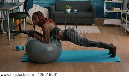 Athletic Fit Woman Working Abdominal Muscle While Sitting On Yoga Swiss Ball During Morning Workout