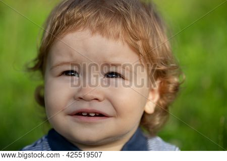 Portrait Of A Cute Child Baby Boy. Close Up Caucasian Kids Face. Closeup Head Of Funny Kid.