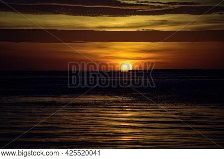 Ocean Sea Sunset. Sunrise Sun Over Skyline Horizon. Natural Sunset Over Ocean. Dramatic Sky.