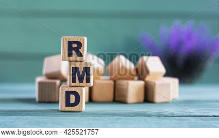 Rmd (required Minimum Distribution) - Acronym On Wooden Cubes On A Green Background With Lavender. B
