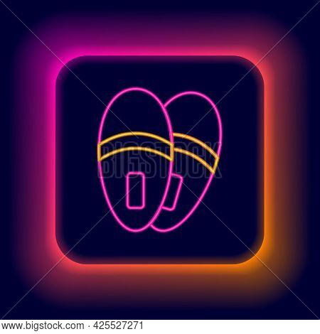 Glowing Neon Line Slippers Icon Isolated On Black Background. Flip Flops Sign. Colorful Outline Conc