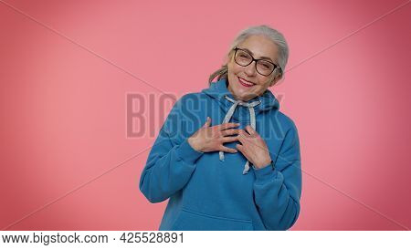 Happy Joyful Senior Old Gray-haired Granny Woman Laughing Out Loud After Hearing Ridiculous Anecdote