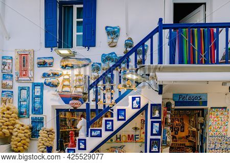 Mykonos Greece April 2018, Colorful Streets Of The Old Town Of Mykonos With Tourists In The Street.