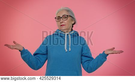 How Could You. Elderly Good-looking Granny Woman Raising Hands In Indignant Expression, Asking Why W