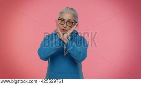 Elderly Granny Gray-haired Woman Say No Hold Palm Folded Crossed Hands In Stop Gesture, Warning Of F