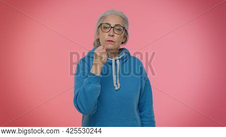 Aggressive Angry Mature Old Granny Good-looking Grandmother Trying To Fight At Camera, Shaking Fist,