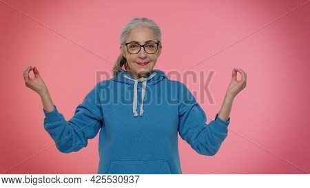 Keep Calm Down, Relax, Inner Balance. Mature Old Granny Woman Breathes Deeply With Mudra Gesture, Ey