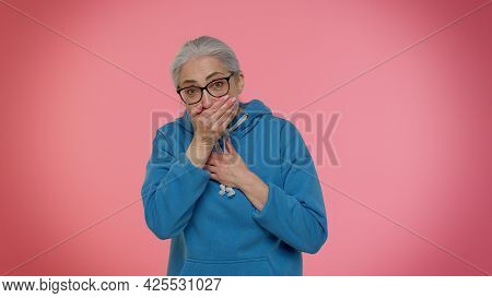 I Will Not Say Anyone. Frightened Elderly Woman Closing Her Mouth With Hand, Looking Intimidated Sca