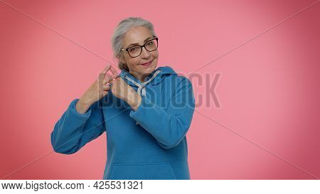 Cheerful Senior Old Granny Woman Showing Hashtag Symbol With Hands, Likes Tagged Message, Popular Vi