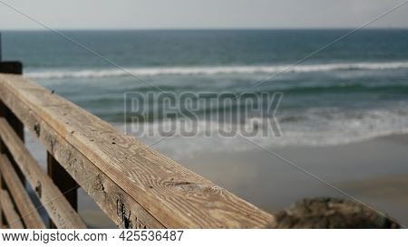 Railings Of Old Wooden Pier, Waterfront Boardwalk, Oceanside Beach Atmosphere, California Coast Usa.