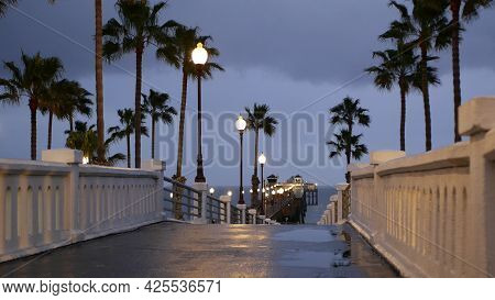 Rain Drops, Evening Dark Sky With Clouds, Oceanside California Usa. Empty Pier And Palm Trees In Twi