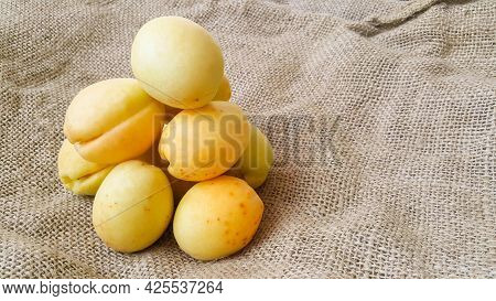 Fresh Apricots On A Burlap Bag. Summer Fruits. Useful Vitamins. Vegetarian Diet. Harvest And Season
