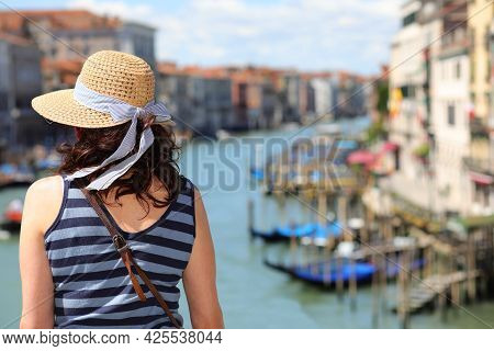 Young Woman With Straw Boater Hat In Venice In Italy On The Rialto Bridge
