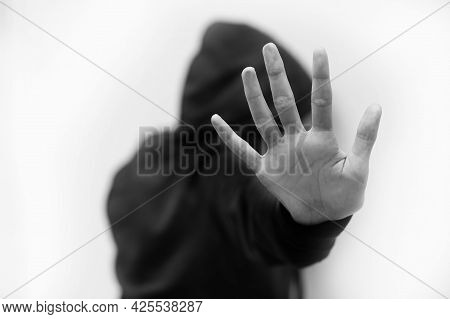 Hand Of Girl Saying Stop Violence With Black And White Effect