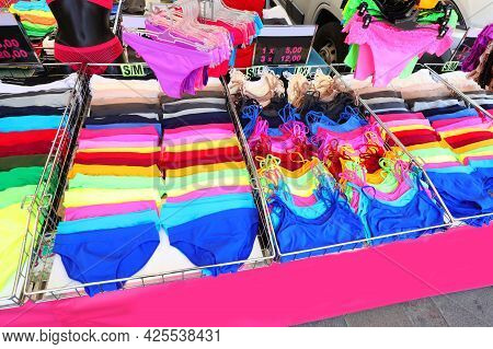 Underwear Stalls With Very Colorful Underwear And Tank Tops For Sale At Market