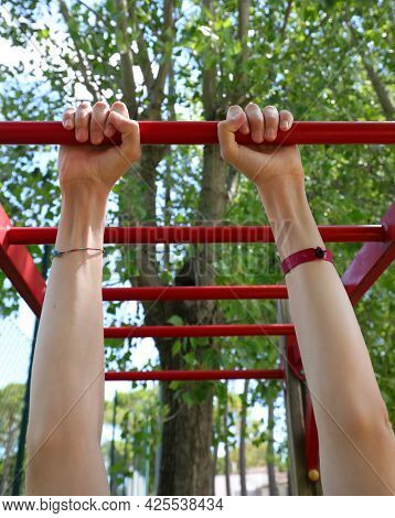 Athlete S Hands Training At The Bars During A Physical Exercise