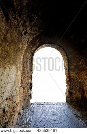 White Light At The End Of A Tunnel Dug Into The Rock Symbol Of Hope Of Passage