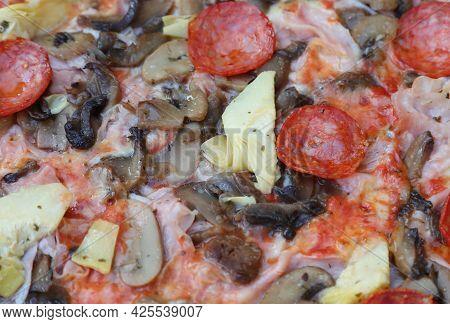 Detail Of Pizza Called Capricciosa With Mushrooms Artichokes Spicy Salami And Tomato Mozzarella In A
