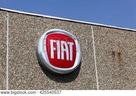 Tilst, Denmark - April 18, 2021: Fiat Logo On A Wall. Fiat Chrysler Automobiles Is An Italian-americ