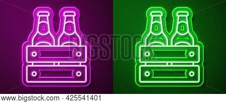 Glowing Neon Line Pack Of Beer Bottles Icon Isolated On Purple And Green Background. Wooden Box And