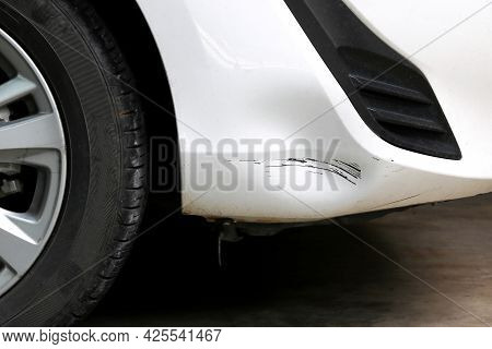 The Scratched On The Car Bumper In Accident.