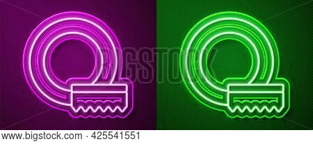 Glowing Neon Line Washing Dishes Icon Isolated On Purple And Green Background. Cleaning Dishes Icon.