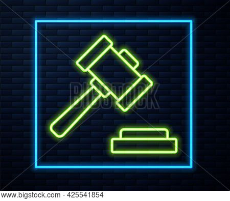 Glowing Neon Line Judge Gavel Icon Isolated On Brick Wall Background. Gavel For Adjudication Of Sent